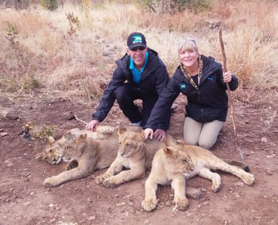Dr. Philip Claussen and Nancy Claussen with Cubs